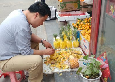 Creating Artful Pineapples in Hutong market